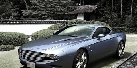 Tire, Automotive design, Rim, Car, Spoke, Fender, Personal luxury car, Alloy wheel, Luxury vehicle, Black,
