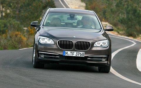 Road, Automotive design, Mode of transport, Vehicle registration plate, Automotive exterior, Vehicle, Road surface, Automotive lighting, Land vehicle, Hood,