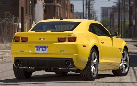 Tire, Wheel, Motor vehicle, Automotive design, Automotive tire, Vehicle, Yellow, Automotive tail & brake light, Land vehicle, Rim,