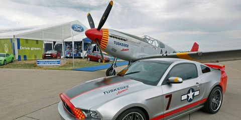 """The Red Tails Mustang with a P-51 Mustang in the Tuskegee Airmens' """"Red Tail"""" livery."""