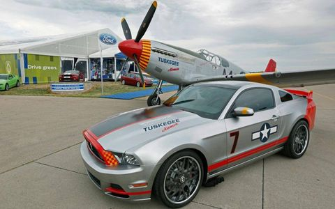 "The Red Tails Mustang with a P-51 Mustang in the Tuskegee Airmens' ""Red Tail"" livery."