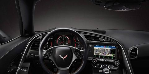 Motor vehicle, Mode of transport, Automotive design, Steering part, Product, Transport, Steering wheel, Speedometer, Center console, Car,