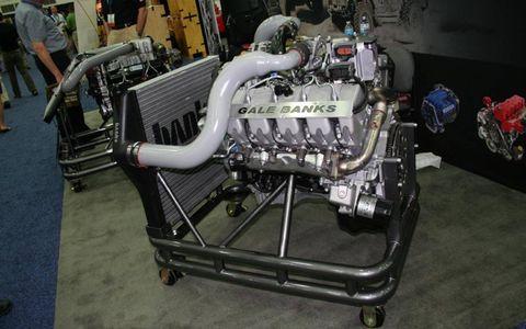 Engine, Auto part, Automotive engine part, Machine, Engineering, Automotive super charger part, Fuel line, Automotive fuel system, Exhaust manifold, Nut,