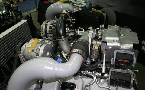 Engine, Automotive engine part, Machine, Auto part, Engineering, Automotive air manifold, Automotive super charger part, Fuel line, Nut, Automotive fuel system,