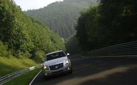 Road, Automotive design, Vehicle, Land vehicle, Infrastructure, Automotive mirror, Car, Automotive exterior, Automotive lighting, Highland,