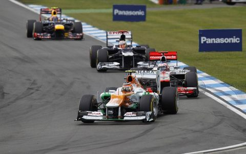 2012 German Grand Prix: Nico Hulkenberg, Force India VJM05 Mercedes, leads Jenson Button, McLaren MP4-27 Mercedes, and Pastor Maldonado, Williams FW34 Renault.