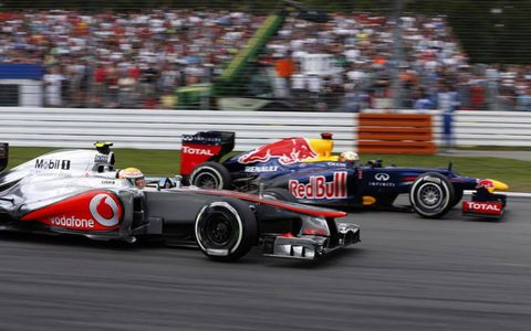 2012 German Grand Prix: Lewis Hamilton, McLaren MP4-27 Mercedes, passes Sebastian Vettel, Red Bull RB8 Renault, to unlap himself.