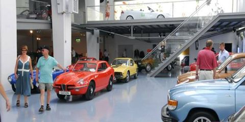 Guests check out the displays of historic Saabs at the Saab Bilmuseum in Trollhattan during the Saab 60th Anniversary celebration.