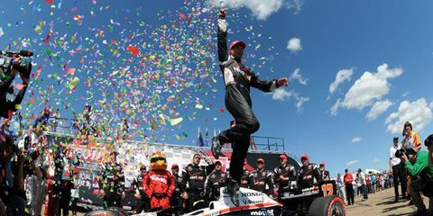 """AIR TIME: Will Power does the """"Power Leap"""" after winning the IndyCar race at Edmonton on July 24."""