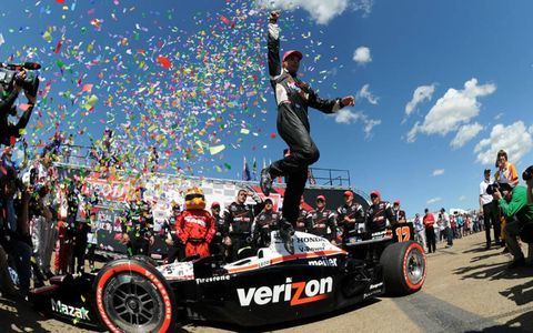"AIR TIME: Will Power does the ""Power Leap"" after winning the IndyCar race at Edmonton on July 24."