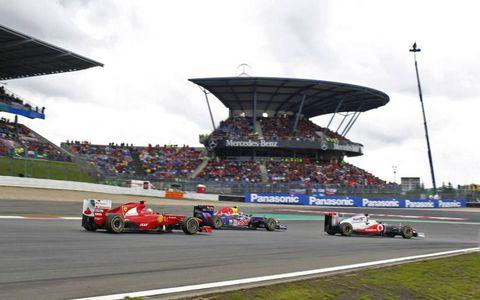 2011 German Grand Prix: Lewis Hamilton, McLaren MP4-26 Mercedes, 1st position, leads