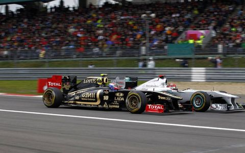 2011 German Grand Prix: Michael Schumacher, Mercedes GP W02 battles with Vitaly Petrov, Lotus Renault GP R31