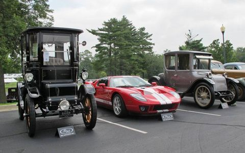 A 2005 Ford GT provides quite a contrast to the electric 1912 Baker Special Extension Coupe (left) and a 1922 Milburn Electric Light Brougham (right).