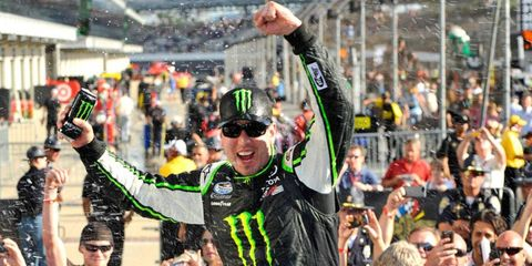 Kyle Busch celebrates his NASCAR Nationwide Series win at the Indianapolis Motor Speedway on Saturday.