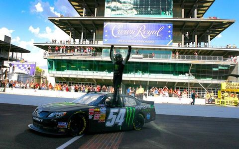 Kyle Busch starts the celebration with the famed Pagoda as a backdrop at the Brickyard.