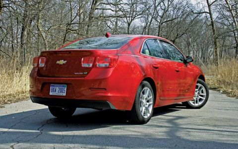 Tire, Wheel, Automotive tail & brake light, Vehicle, Land vehicle, Car, Rim, Red, Alloy wheel, Full-size car,