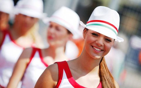 Grid girls did their best to keep cool on a hot day in Hungary.