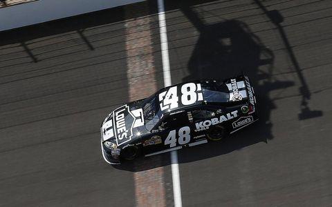 Automotive exterior, Automotive decal, Logo, Motorsport, Touring car racing, Race car, Symbol, Race track, Auto racing, Graphics,