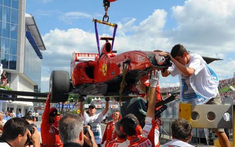 Hungaroring, Budapest, Hungary 25th July 2009 The damaged Ferrari F60 of Felipe Massa is returned to the pits after his accident.