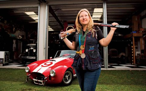 Kim Rhode stands with her gun and her Cobra.