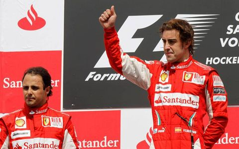 Hockenheimring, Hockenheim, Germany 25th July 2010 Felipe Massa, Ferrari F10, 2nd position, and Fernando Alonso, Ferrari F10, 1st position, on the podium.