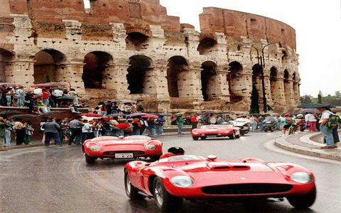 To celebrate the 50th anniversary of Ferrari's first racing win, the company staged a parade of vintage Ferraris past the crumbling hulk of the Colosseum in Rome on June 1, 1997. The celebration included a display of famous cars from the company's past and may of its drivers through the years.