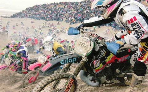 Sand dunes in northern France attract some 700 riders for the 21st Le Touquet motorcycling enduro race in February 1996. Thousands of spectators gather to watch.