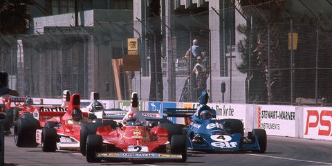 Action at the 1976 United States Grand Prix West in Long Beach, California. Clay Regazzoni leads in his Ferrari 312T.