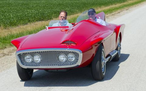 Automotive design, Mode of transport, Grass, Vehicle, Automotive exterior, Red, Car, Hood, Fender, Automotive tire,