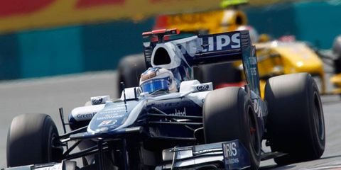Hungaroring, Budapest, Hungary 1st August 2010 Rubens Barrichello, Williams FW32 Cosworth, 10th position, leads Vitaly Petrov, Renault R30, 5th position.