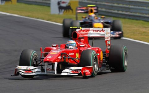 Hungaroring, Budapest, Hungary 1st August 2010 Fernando Alonso, Ferrari F10, 2nd position, leads Mark Webber, Red Bull Racing RB6 Renault, 1st position.