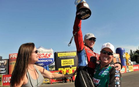 Courtney Force celebrates her first Funny Car win with father and team owner John Force.