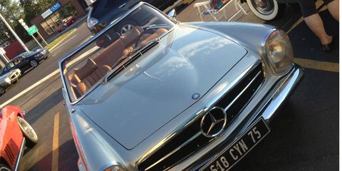 Imports like this Mercedes line Woodward Avenue well ahead of the official Dream Cruise.