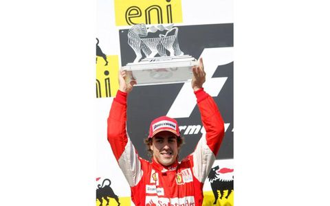 Hungaroring, Budapest, Hungary 1st August 2010 Fernando Alonso, Ferrari F10, 2nd position, with his trophy.
