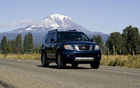 Motor vehicle, Automotive mirror, Road, Vehicle, Automotive lighting, Automotive exterior, Infrastructure, Automotive tire, Mountainous landforms, Car,