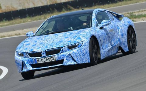 A carbon fiber structure and hybrid drivetrain help make the BMW i8 fuel efficent and fun.