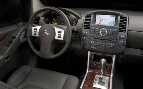 Motor vehicle, Steering part, Automotive design, Product, Steering wheel, Center console, Car, White, Technology, Electronic device,