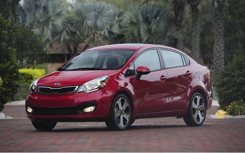 Tire, Wheel, Mode of transport, Automotive design, Automotive mirror, Vehicle, Glass, Car, Red, Automotive lighting,