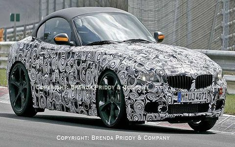 Groovy! It's BMW's new Z4 with its new folding hardtop artfully hidden under some fabric.