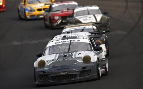 2012 Brickyard Grand Prix: The #44 of Andy Lally and John Potter leads late in the race