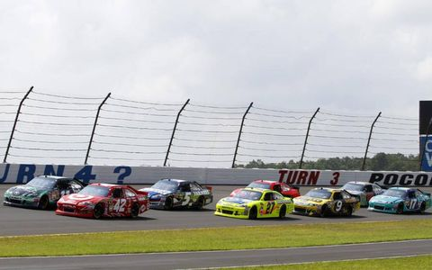 2012 NASCAR Sprint Cup Series at Pocono: Juan Pablo Montoya and Denny Hamlin lead the field to the green flag at the start of the race
