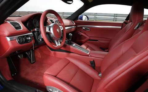 The 2014 Porsche Cayman S interior comes in red leather for an additional $3,895.