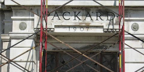 Scaffolding in front of the Packard building facade, so it can be moved to a museum.