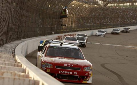 Aric Almirola leads a line of cars in his No. 88 Chevrolet Impala. Photo by: Lesley Ann Miller/LAT Photographic