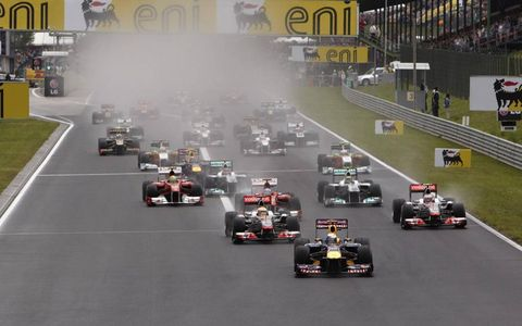 Red Bull Racing's Sebastian Vettel leads the Formula One field into turn one at the start of the Hungarian Grand Prix on July 31. Photo by: Steve Etherington/LAT Photographic