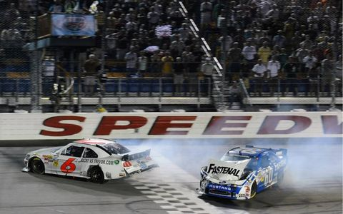 FRIENDLY PUSH // The No. 6 driven by Ricky Stenhouse Jr. blew its engine in a huge plume of white smoke as he approached the finish line. But Stenhouse got some help across from teammate Carl Edwards, who blindly slammed into Stenhouse and pushed him over the line to take the victory at Iowa Speedway on Aug. 6.