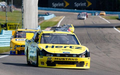Brad Keselowski leads teammate Sam Hornish Jr. at Watkins Glen.