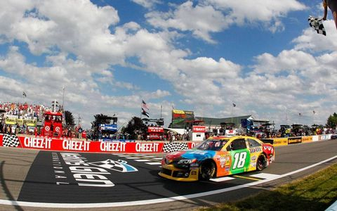 Kyle Busch takes the checkered flag at Watkins Glen on Sunday.