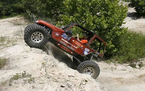Tire, Automotive tire, Rim, Off-road vehicle, Tread, All-terrain vehicle, Auto part, Sand, Automotive wheel system, Synthetic rubber,