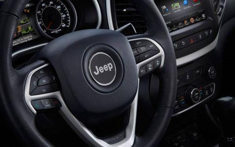 2014 Jeep Cherokee interior and steering wheel detail.